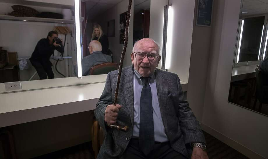 Ed Asner playfully fends off a photographer shooting his portrait in the green room at the Jewish Community Center in San Francisco. Photo: Paul Kuroda, Special To The Chronicle