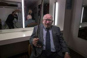 Ed Asner playfully fends off a photographer shooting his portrait in the green room at the Jewish Community Center on Friday, Oct. 20, 2017 in San Francisco, Calif.