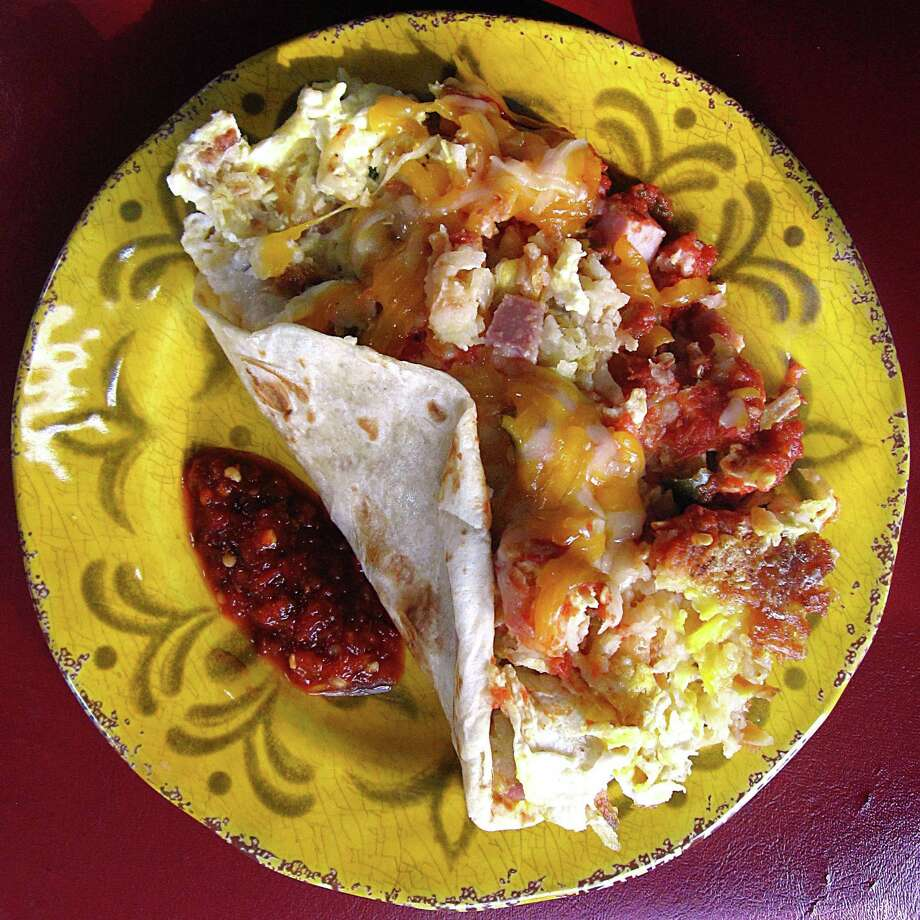 Migas taco on a flour tortilla from Grumpy's Mexican Cafe. Photo: Mike Sutter /San Antonio Express-News