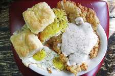 Chicken-fried steak and eggs breakfast with hashbrowns and biscuits from Grumpy's Mexican Cafe.