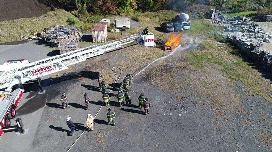 Members of the Danbury Fire Department's D Platoon participate in a live burn training at the Danbury Fire School. Photo: / Contributed