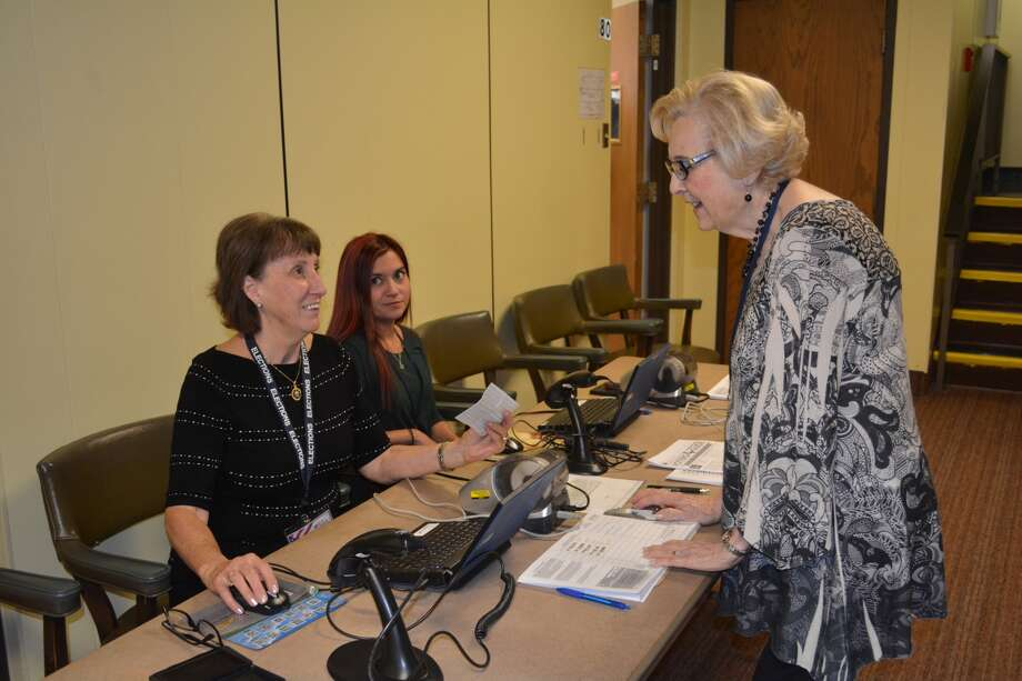 Election workers Diane Dowdy (left) and Eriyn Castillo help fellow election worker Mary Ann Cross with the preliminaries Monday morning for casting an early ballot in the 2017 Texas Constitutional Amendments Election which is combined with the City of Plainview Bond Election. Local voters are deciding the fate of six bond propositions ranging from reconstruction of 24th Street to relocating the Police Station and City Hall, constructing a new fire substation, improvements to the 16th Street Swimming Pool, improvements to the youth baseball and adult softball fields and downtown streetscape improvements. Early voting continue weekdays this week and next week with Election Day on Tuesday, Nov. 7. Local voting is in the courthouse basement.