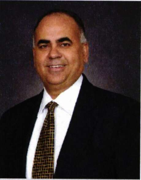 """The Office of the Comptroller of the Currency recently imposed a $250,000 civil penalty against Saul Ortega, the former chairman, CEO, president and CFO of First National Bank of Edinburg over its """"unsafe and unsound practices."""" The bank was shut down by regulators in 2013. Ortega is pictured in a Texas National Bank annual report that was filed with the Federal Reserve Bank of Dallas. Photo: Courtesy / COURTESY DALLAS FEDERAL RESERVE BANK"""