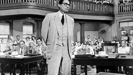 "The powerful novel, ""To Kill a Mockingbird,"" was made into a powerful movie, starring  Gregory Peck as Atticus Finch, shown here. A school board in Biloxi, Miss. has removed the book because it ""offends"" some. The problem: It is supposed to do just that — it is a lesson in empathy."