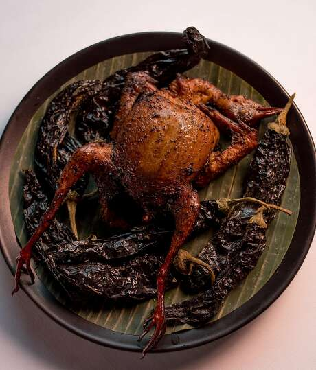Squab fresh from the smoker at Californios. Photo: John Storey, Special To The Chronicle
