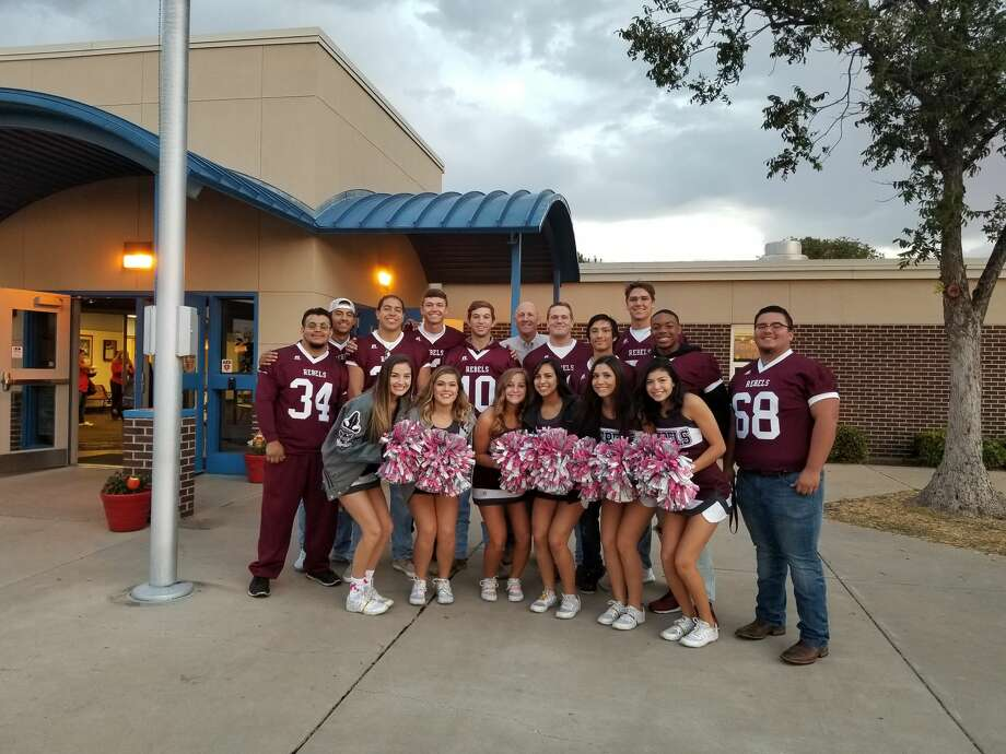 LHS football players and cheerleaders spent part of Friday morning at Long Elementary opening car doors and greeting students.  Photo: Courtesy Of Terri Rimer, Jane Long Principal