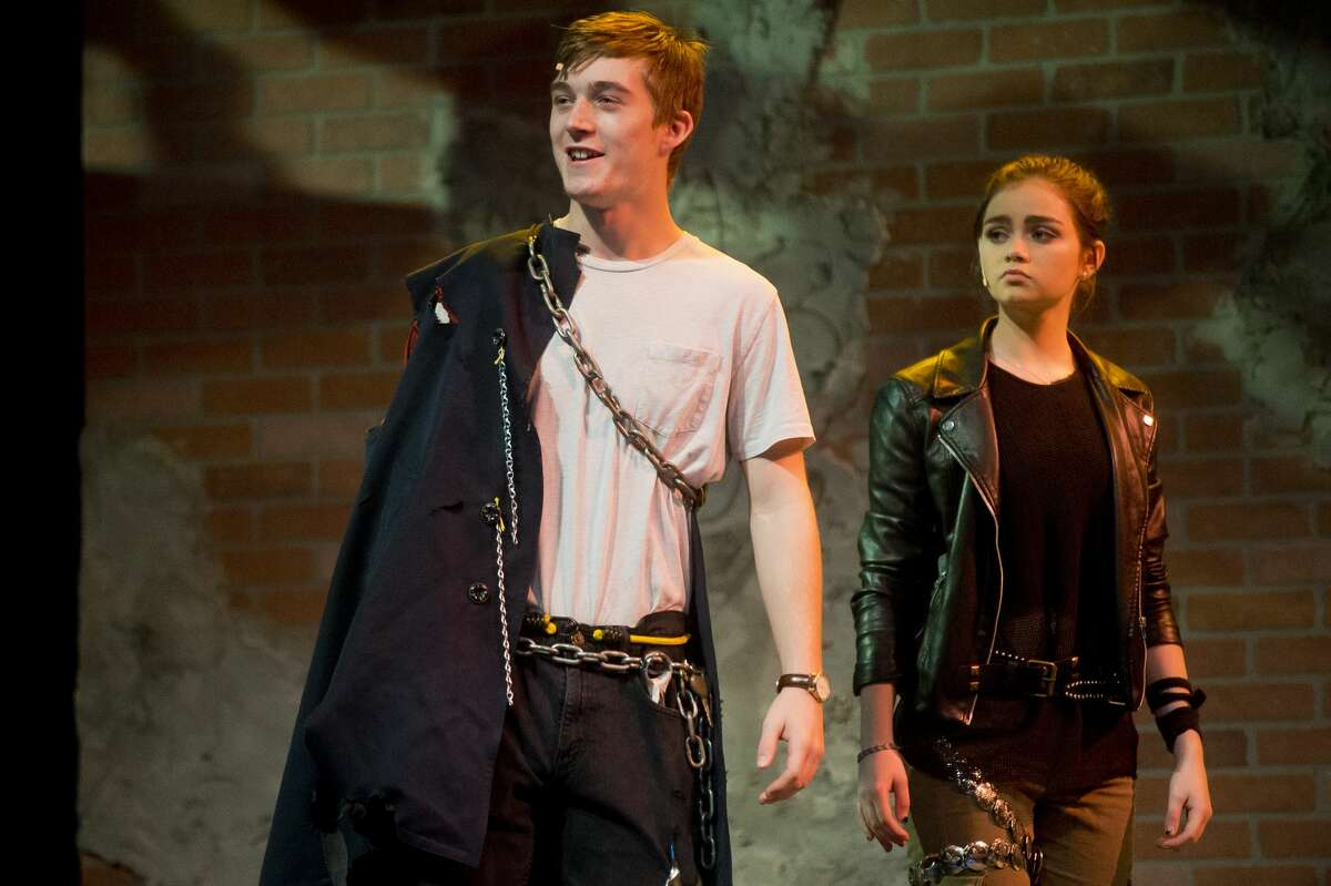 Nick Kerkav, playing the role of Malcolm, left, and Emma Brown, playing the role of Donalbain, act out a scene during dress rehearsal for Midland High School's production of MacBeth on Monday, Oct. 23, 2017 at Central Auditorium. (Katy Kildee/kkildee@mdn.net)