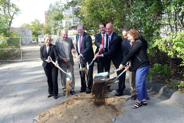 Stamford mayor David Martin (center left), U.S. Rep. Jim Himes (center) and Inspirica CEO Jason Shaplen (center right) lead the ceremonial groundbreaking of 72 Franklin Street, which will be developed into deeply affordable housing units, in downtown Stamford, Conn. on Monday, Oct. 23, 2017.