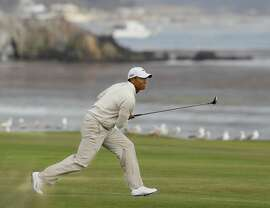 Tiger Woods watches his approach shot to the 18th green during the third round of the U.S. Open golf tournament Saturday, June 19, 2010, at the Pebble Beach Golf Links in Pebble Beach, Calif. (AP Photo/Eric Risberg)