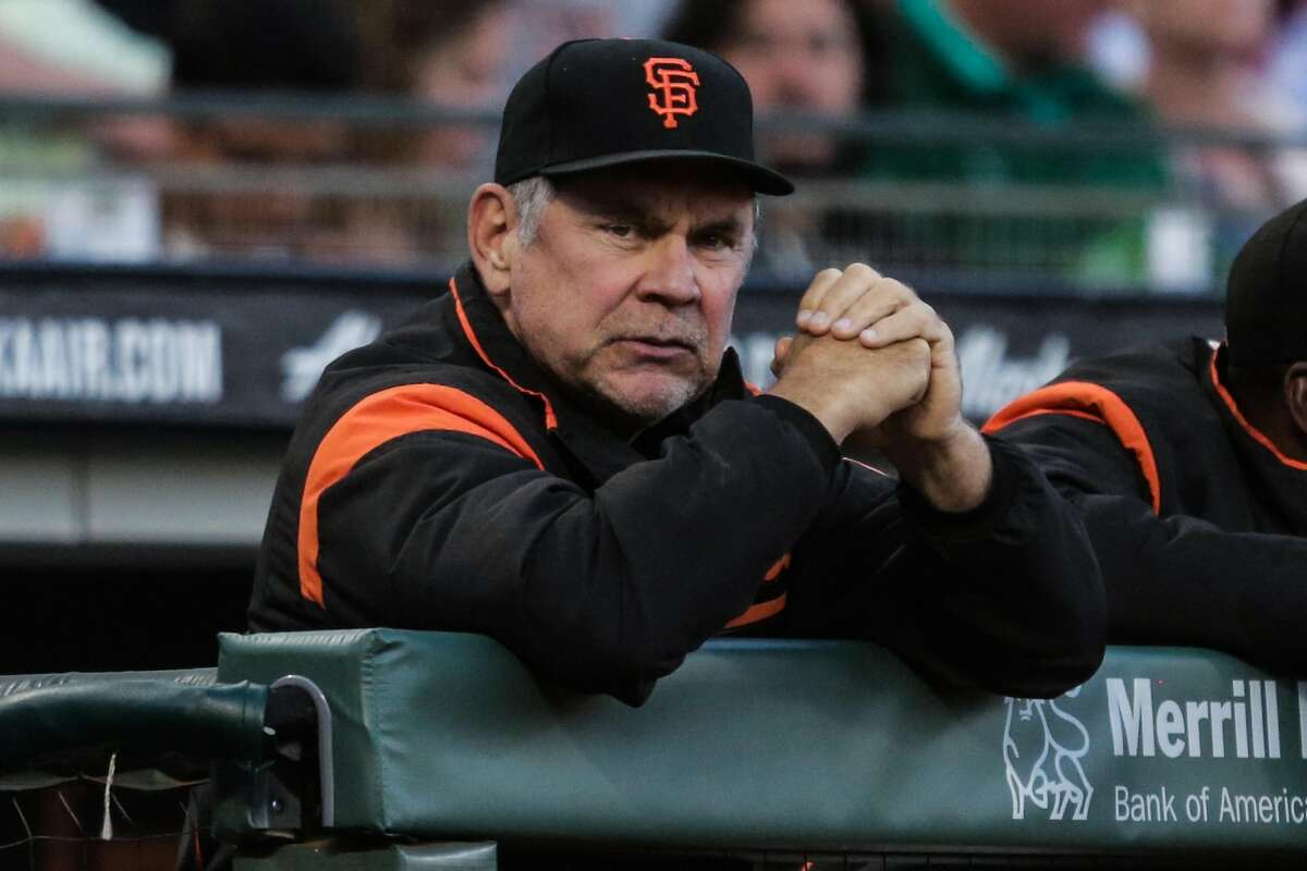 Giants' manager Bruch Bochy (15) watches the game between the San Francisco Giants and the Milwaukee Brewers at AT&T Park in San Francisco, Calif., on Tuesday, Aug. 22, 2017.