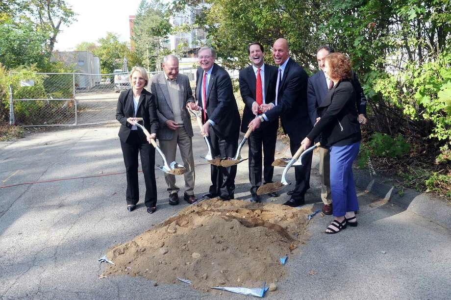 Stamford mayor David Martin (center left), U.S. Rep. Jim Himes (center) and Inspirica CEO Jason Shaplen (center right) lead the ceremonial groundbreaking of 72 Franklin Street, which will be developed into deeply affordable housing units, in downtown Stamford, Conn. on Monday, Oct. 23, 2017. Photo: Michael Cummo / Hearst Connecticut Media / Stamford Advocate