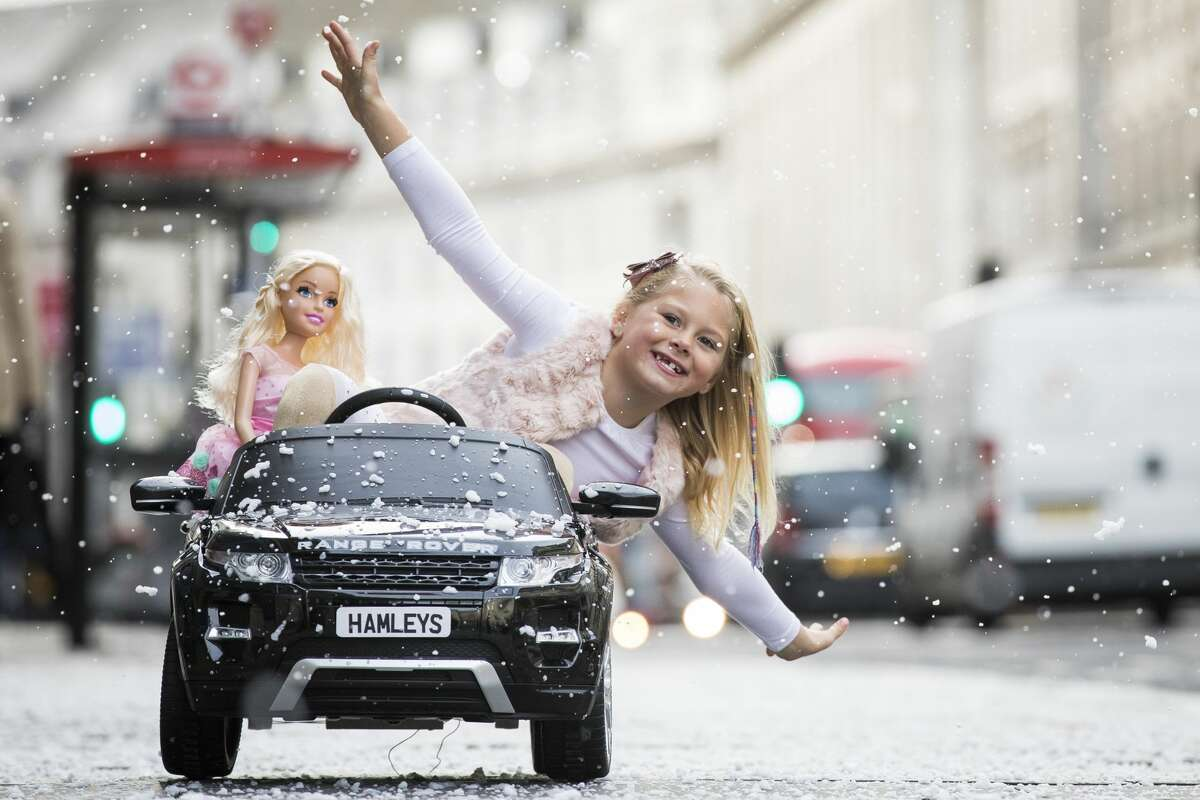 A girl drives a Range Rover Evoque Ride-on electric car on Regents Street as Hamley's announce it's top ten toys for Christmas at Hamleys on October 12, 2017 in London, England. >>Here is a look at Hamleys top 10 toys for Christmas 2017...