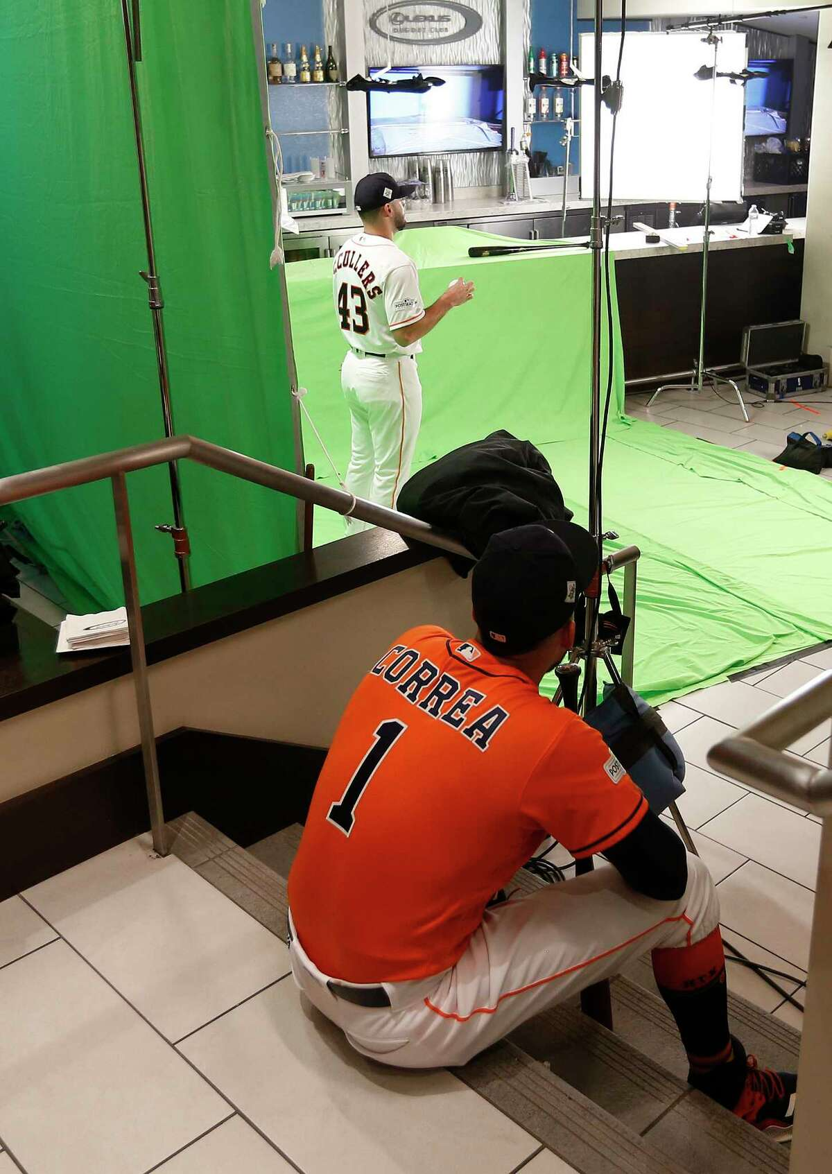 Houston Astros Carlos Correa waits his turn in line as pitcher Lance McCullers Jr. gets his photo taken during a photo shoot at the World Series Media Day at Dodger Stadium, Monday, Oct. 23, 2017, in Los Angeles.