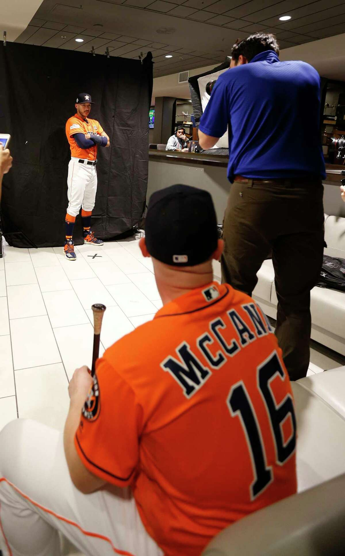 Houston Astros catcher Brian McCann waits for Carlos Correa to finsh getting his photo taken by MLB photographer Alex Trautwig during the World Series Media Day at Dodger Stadium, Monday, Oct. 23, 2017, in Los Angeles.