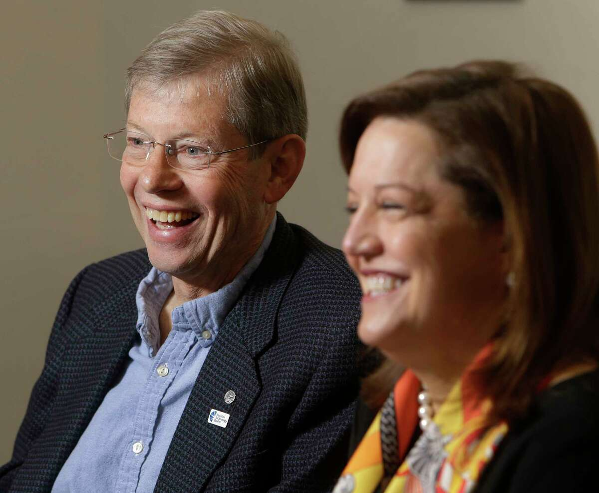 Walter Ulrich, former CEO, and new CEO Lori Vetters share a laugh as they talk at Houston Technology Center, 410 Pierce Street, Friday, Jan. 6, 2017, in Houston. ( Melissa Phillip / Houston Chronicle )