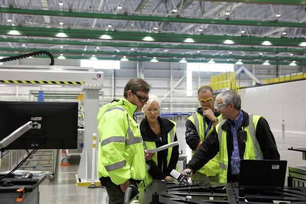 Employees work in the new Composite Wing Facility, which will be the home of wing production on the new 777x, Monday, Oct. 23, 2017 in Everett.