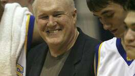 Alamo Heights players surround coach Charlie Boggess after his 700th career win, coming against Fox Tech, in 2007.
