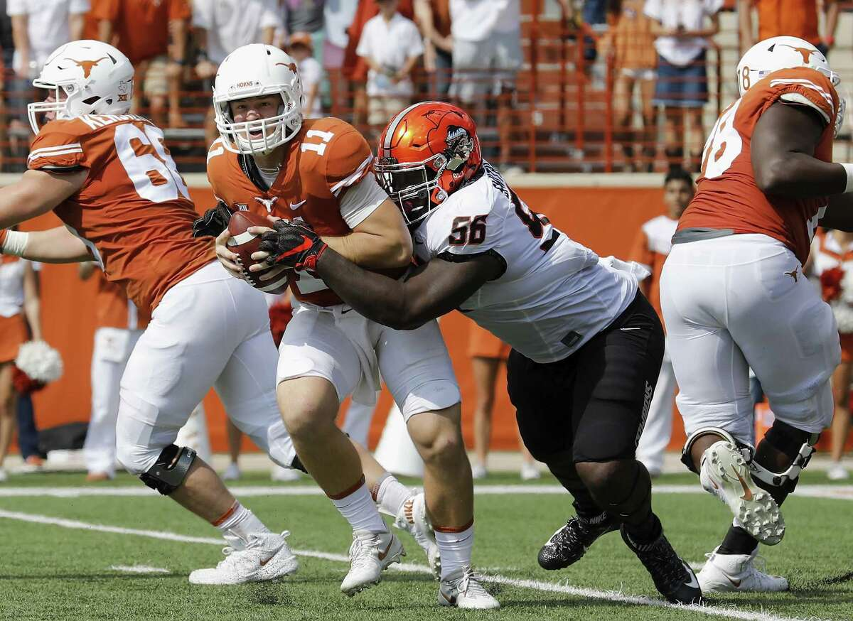 The status of quarterback Sam Ehlinger (11) is uncertain as a result of being in the concussion pro-tocol after Saturday's loss to Oklahoma State.