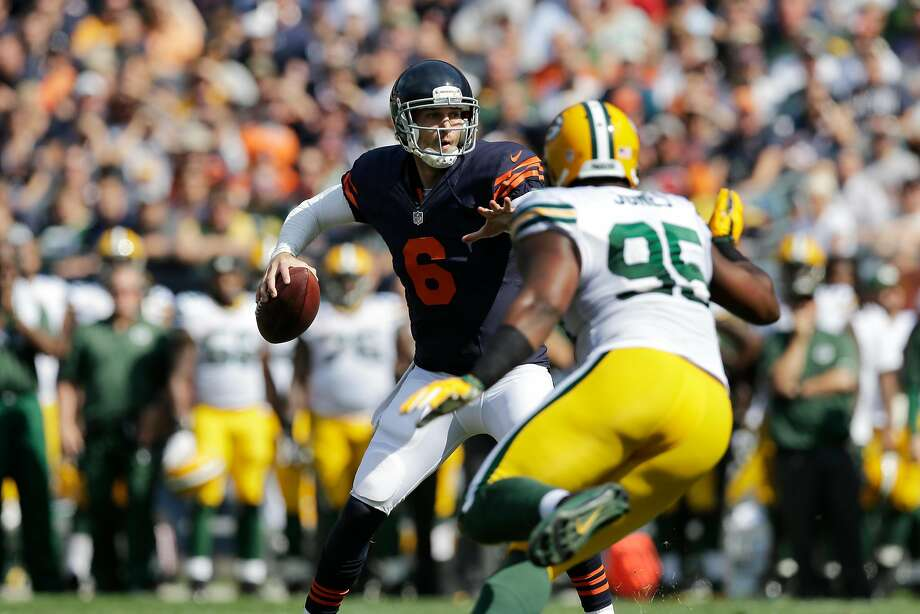 Chicago Bears quarterback Jay Cutler (6) passes under pressure from Green Bay Packers defensive end Datone Jones (95) in the first half of an NFL football game Sunday, Sept. 28, 2014, in Chicago. (AP Photo/Nam Y. Huh) Photo: Nam Y. Huh, Associated Press