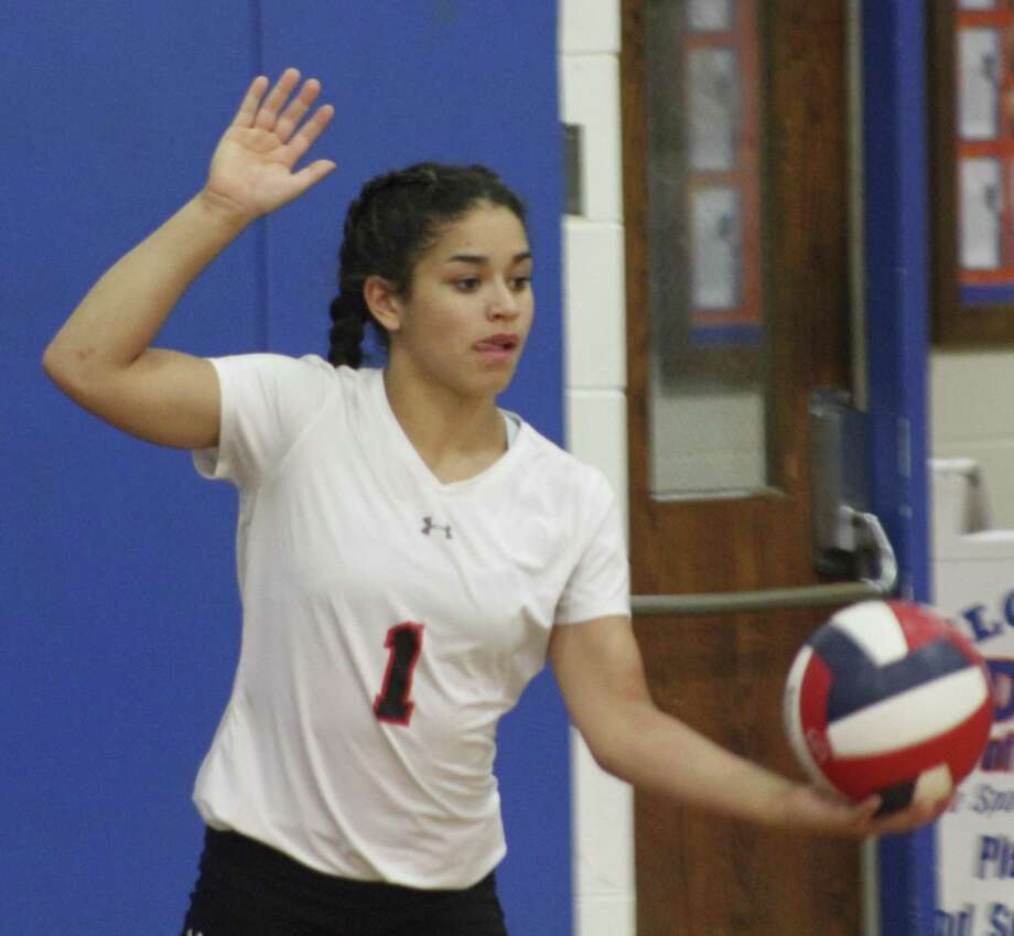 Greenwich's Adnerys DeJesus lines up a serve during the girls volleyball game against Danbury at Danbury High School Oct. 23, 2017. Photo: Richard Gregory / Richard Gregory