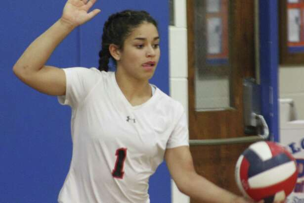 Greenwich's Adnerys DeJesus lines up a serve during the girls volleyball game against Danbury at Danbury High School Oct. 23, 2017.