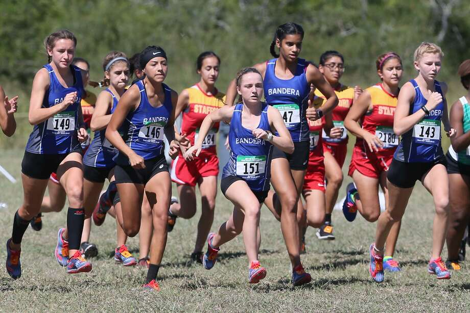 The Bandera girls team takes off from the start of the Region IV 4A cross country championships at Texas A&M Corpus Christi on Oct. 23. Photo: Marvin Pfeiffer /San Antonio Express-News / Express-News 2017