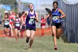 Boerne's Emma Stauber, left, races Bandera's Alia Henderson to the finish line of the Region IV 4A cross country championships at Texas A&M Corpus Christi on Oct. 23. Stauber finished first with a time of 11 minutes, 55 seconds while Henderson was second in 11 minutes, 57 seconds. The Bandera girls took the team title in the event.
