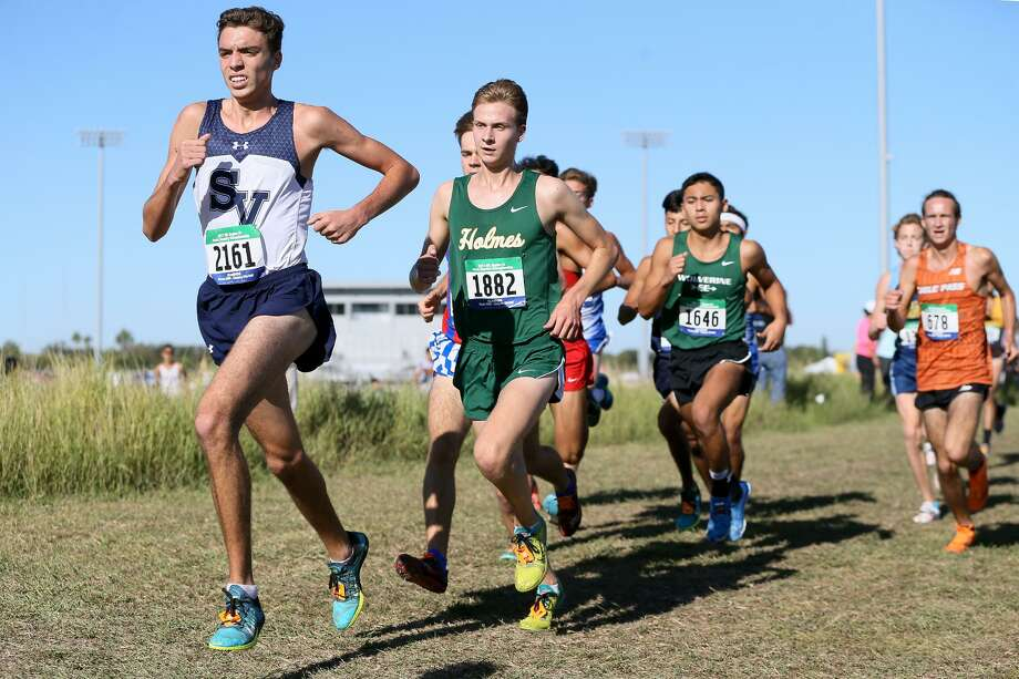 Smithson Valley's Clayton Wilkerson, left, runs ahead of Holmes' Ethan Hageman during the 6A Boys Region IV cross country championships. Photo: Marvin Pfeiffer /Staff Photographer / Express-News 2017