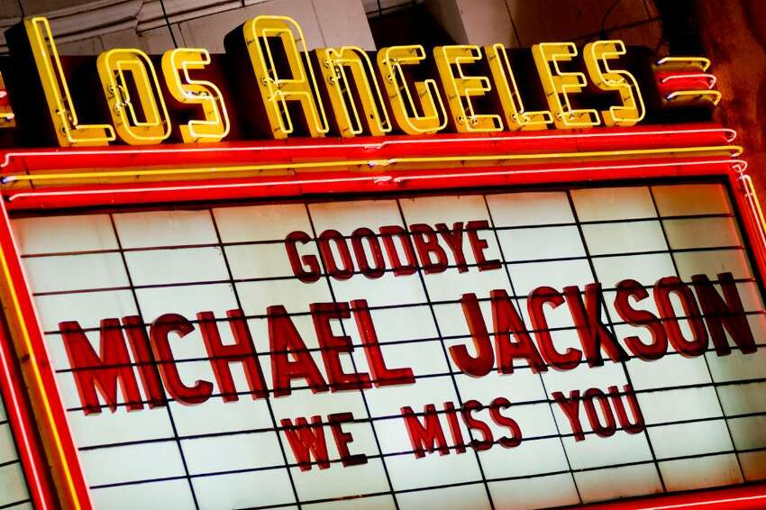 LOS ANGELES - JUNE 27: The Los Angeles Theater Marquee honours Michael Jackson on June 27, 2009 in Los Angeles, California. Jackson, 50, the iconic pop star, died after going into cardiac arrest on June 25, 2009 in Los Angeles, California. (Photo by Michal Czerwonka/Getty Images)