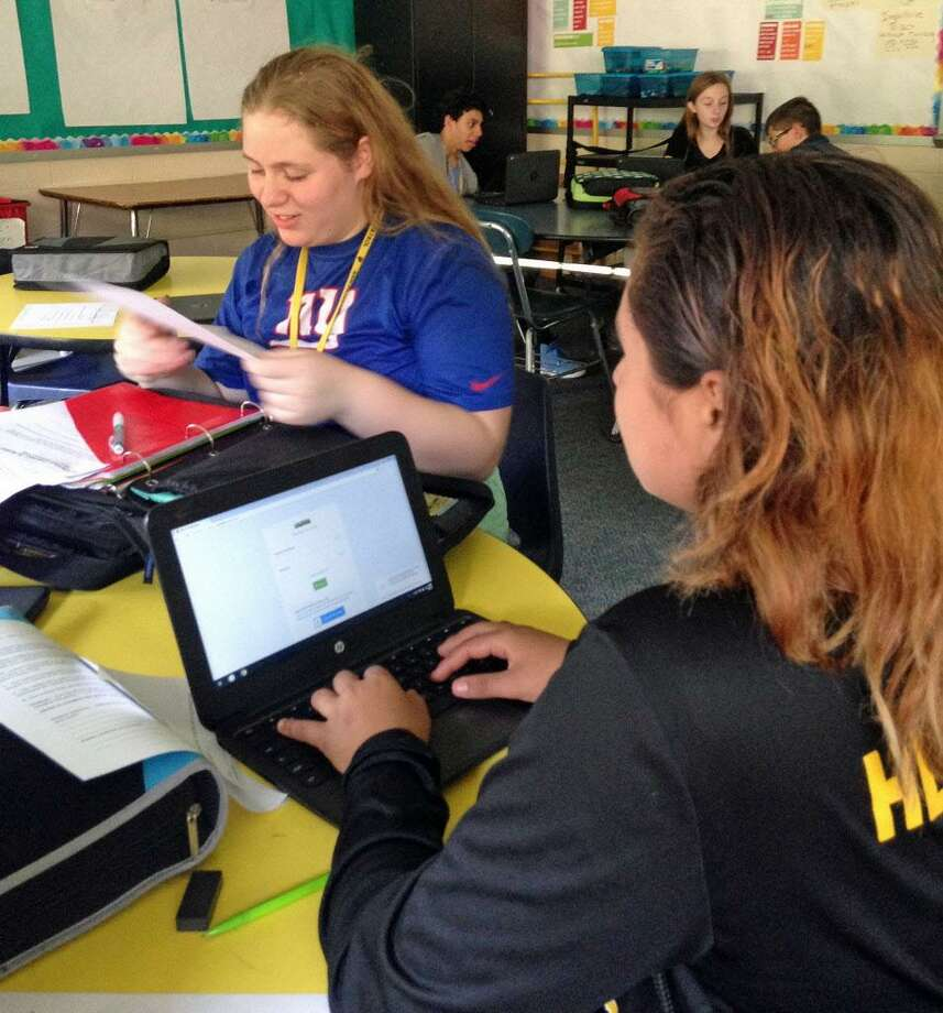 Woodrow Wilson Middle School students work on a vocabulary assignment in LisaMarie Sherman's reading class on Monday. Photo: LisaMarie Sherman Photo /