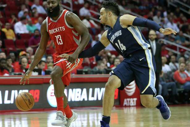 Memphis Grizzlies forward Dillon Brooks (24) attempts to steal the ball from Houston Rockets guard James Harden (13) during the first quarter of the NBA game at Toyota Center Monday, Oct. 23, 2017, in Houston.