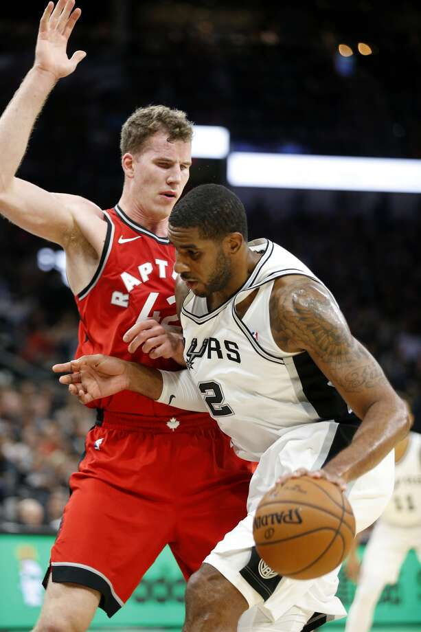 San Antonio Spurs' LaMarcus Aldridge looks for room around Toronto Raptors' Jakob Poeltl during first half action Monday Oct. 23, 2017 at the AT&T Center.