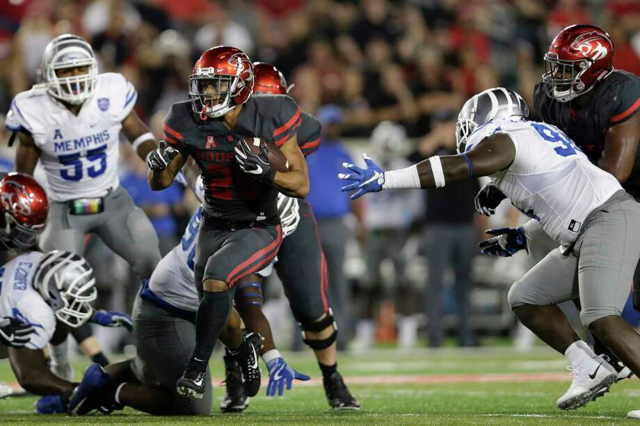 Houston Cougars running back Duke Catalon #2 runs past the tackle attempt by Memphis Tigers defensive lineman Joseph Dorceus #94 in the fourth quarter during the NCAA football game between the Memphis Tigers and the Houston Cougars at TDECU Stadium in Houston, TX on Thursday, October 19, 2017. Photo: Tim Warner, Freelance / Houston Chronicle