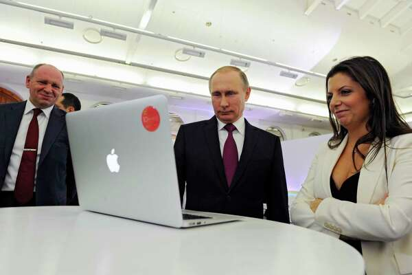 Margarita Simonyan, the editor-in-chief of RT, marks the  news channel's 10th anniversary in 2015 with Russian President Vladimir Putin.