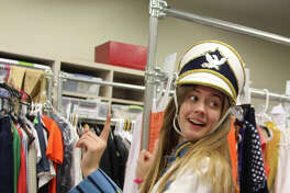 """Senior Mallory Bechtel, who plays the lead role of Elle in The John Cooper School production of """"Legally Blonde, The Musical"""" gets fitted for a costume."""