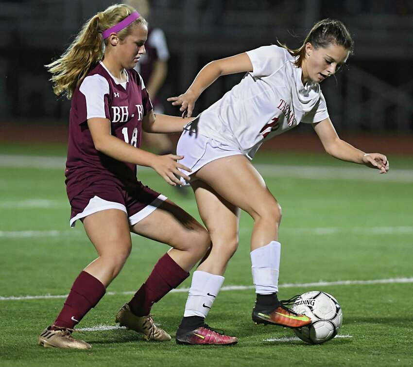 Burnt Hills' Cassidy Karl, left, battles for the ball with Scotia's Haley Bonitatibus during a semi-final soccer game on Monday, Oct 23, 2017 in Stillwater, N.Y. (Lori Van Buren / Times Union)
