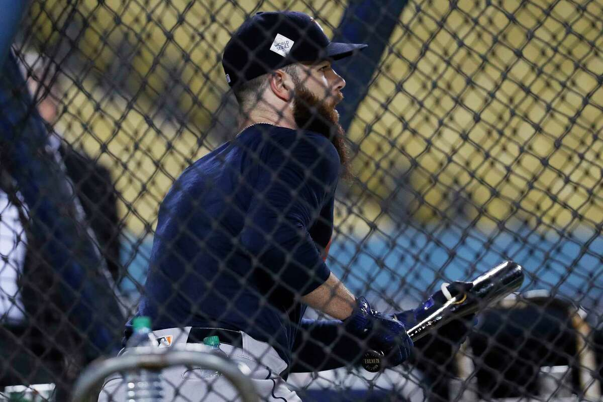Houston Astros starting pitcher Dallas Keuchel (60) lines up for a bunt during batting practice during the World Series Media Day at Dodger Stadium, Monday, Oct. 23, 2017, in Los Angeles.