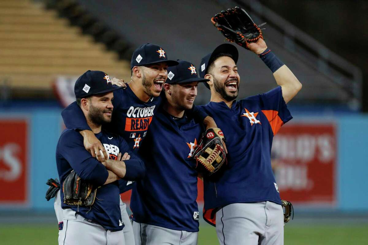 From left, Houston Astros second baseman Jose Altuve (27), shortstop Carlos Correa (1), third baseman Alex Bregman (2) and left fielder Marwin Gonzalez (9) laugh as they stand arm in arm as the Astros work out during the World Series Media Day at Dodger Stadium, Monday, Oct. 23, 2017, in Los Angeles.