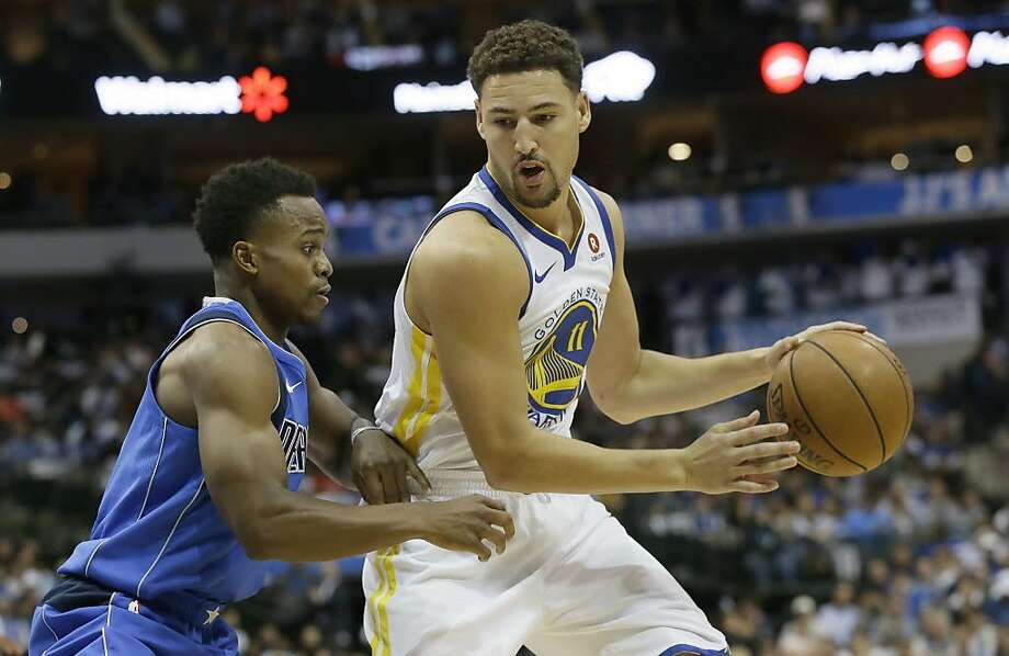 Golden State Warriors guard Klay Thompson (11) dribbles against Dallas Mavericks guard Yogi Ferrell during the first half of an NBA basketball game in Dallas, Monday, Oct. 23, 2017. (AP Photo/LM Otero) Photo: LM Otero, Associated Press
