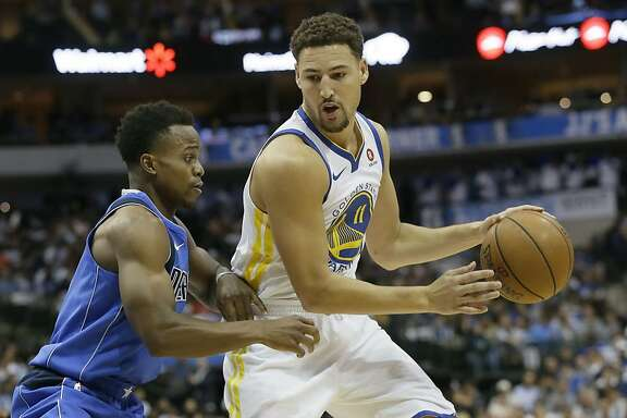Golden State Warriors guard Klay Thompson (11) dribbles against Dallas Mavericks guard Yogi Ferrell during the first half of an NBA basketball game in Dallas, Monday, Oct. 23, 2017. (AP Photo/LM Otero)