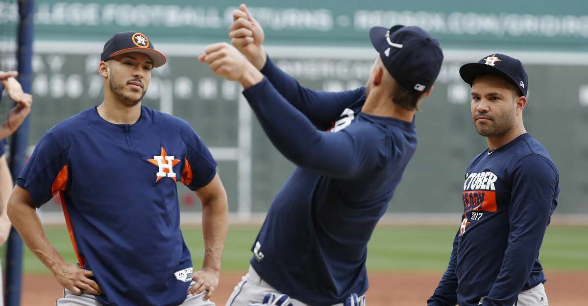 Houston Astros Carlos Correa and Jose Altuve watch George Springer talk about hitting during the Astros workout at Fenway Park, Saturday, Oct. 7, 2017, in Boston , ahead of Sunday's ALDS Game 3. ( Karen Warren / Houston Chronicle )