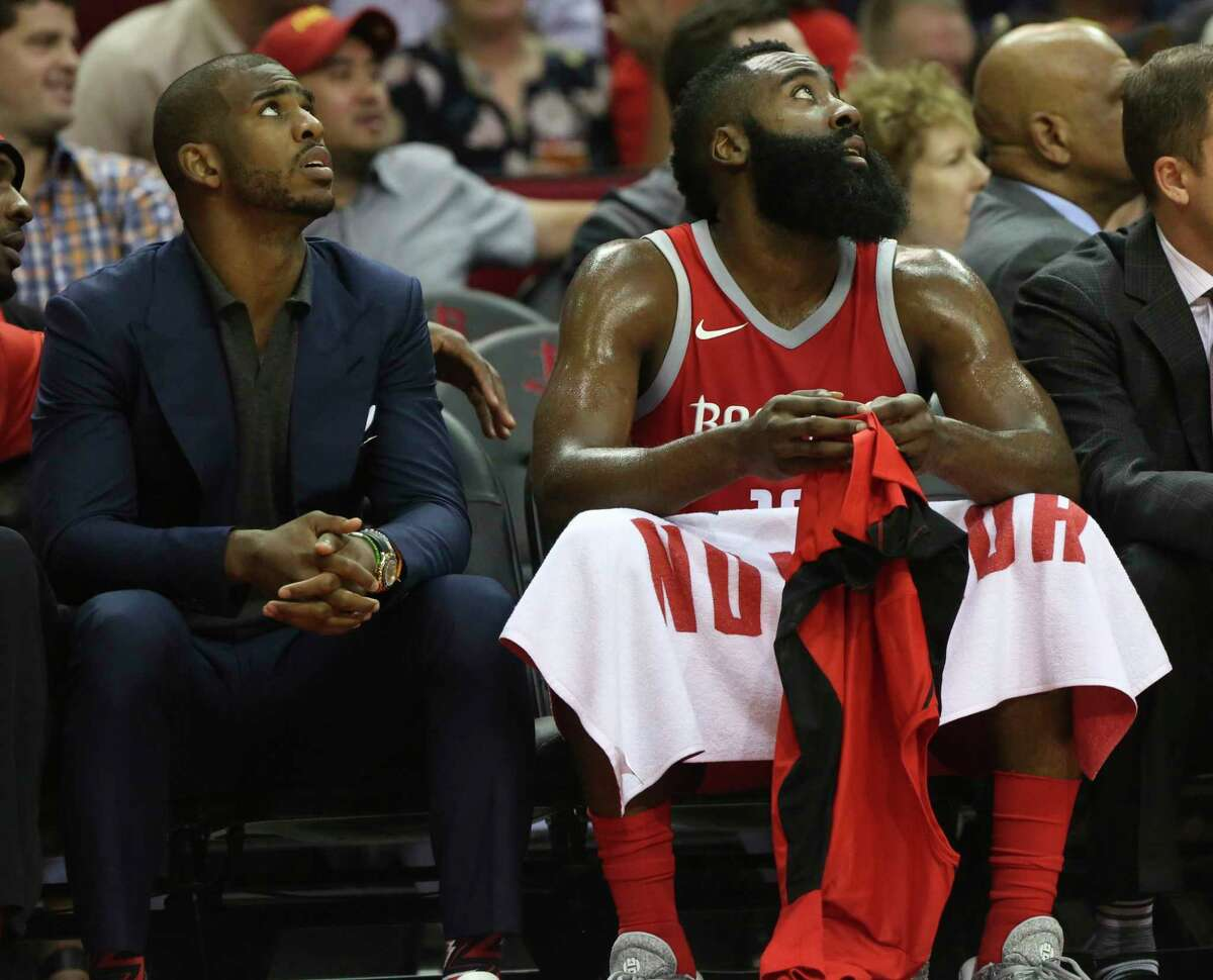 Houston Rockets guard James Harden (13) and Chris Paul (3) watch a replay from the sideline during the first quarter of the NBA game at Toyota Center Monday, Oct. 23, 2017, in Houston.