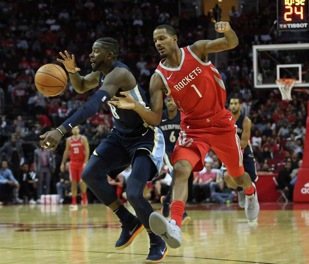 Houston Rockets forward Trevor Ariza (1) tries to steal the ball from Memphis Grizzlies forward James Ennis III (8) during the fhourth quarter of the NBA game at Toyota Center Monday, Oct. 23, 2017, in Houston. The Houston Rockets lost to the Memphis Grizzlies 98-90.