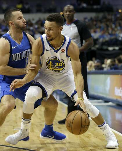 6a7be184ebb8 Golden State Warriors guard Stephen Curry (30) drives against Dallas  Mavericks guard J.J. Barea (5) during the first half of an NBA basketball  game in ...