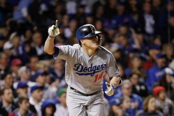CHICAGO, IL - OCTOBER 19:  Enrique Hernandez #14 of the Los Angeles Dodgers reacts to hitting a grand slam in the third inning against the Chicago Cubs during game five of the National League Championship Series at Wrigley Field on October 19, 2017 in Chicago, Illinois.  (Photo by Jamie Squire/Getty Images)