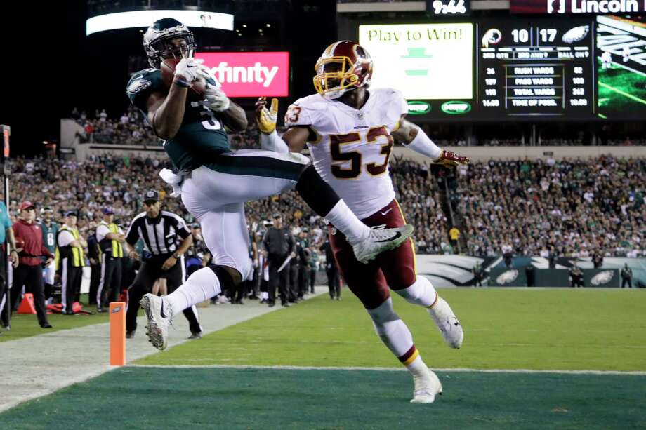 Philadelphia Eagles running back Corey Clement, left, makes a touchdown catch on a pass from quarterback Carson Wentz, not pictured, as Washington Redskins inside linebacker Zach Brown (53) defends during the second half of an NFL football game, Monday, Oct. 23, 2017, in Philadelphia. (AP Photo/Michael Perez) ORG XMIT: PXE116 Photo: Michael Perez / FR 168006 AP