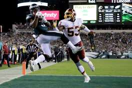 Philadelphia Eagles running back Corey Clement, left, makes a touchdown catch on a pass from quarterback Carson Wentz, not pictured, as Washington Redskins inside linebacker Zach Brown (53) defends during the second half of an NFL football game, Monday, Oct. 23, 2017, in Philadelphia. (AP Photo/Michael Perez) ORG XMIT: PXE116