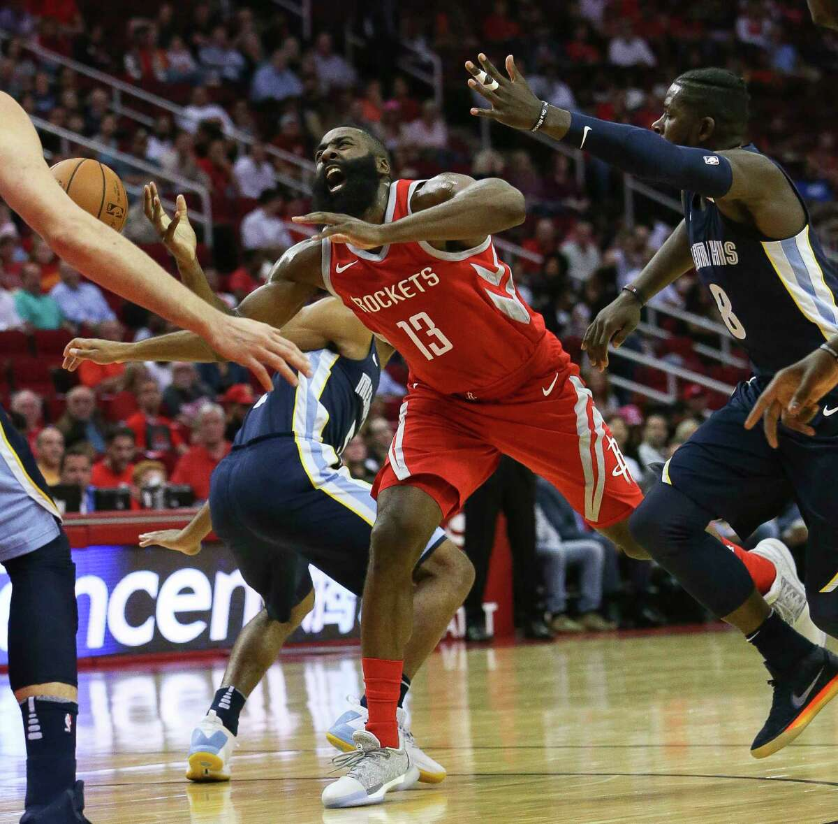 Houston Rockets guard James Harden (13) reacts to being fauled by Memphis Grizzlies forward James Ennis III (8) and loses the ball during the first quarter of the NBA game at Toyota Center Monday, Oct. 23, 2017, in Houston. ( Yi-Chin Lee / Houston Chronicle )
