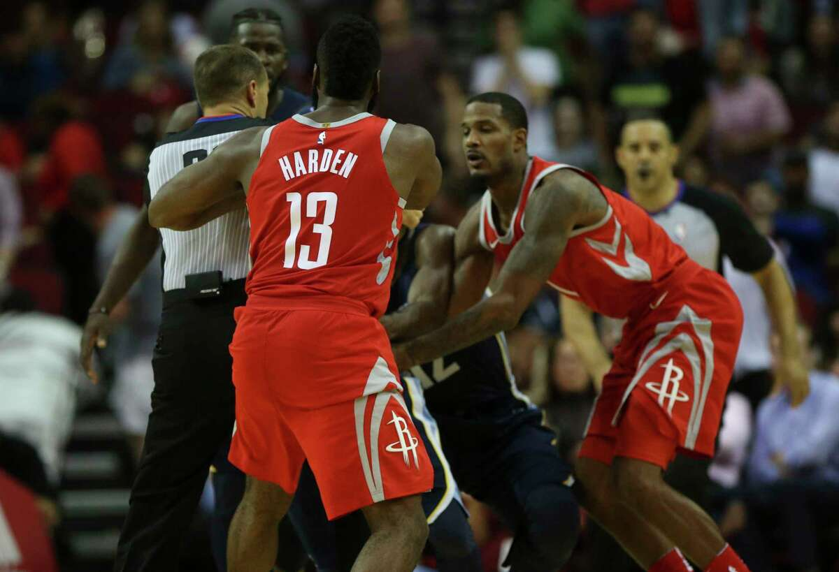 Rockets guard James Harden (13) is separated from the Grizzlies' Mario Chalmers, left, after a confrontation in the fourth quarter.