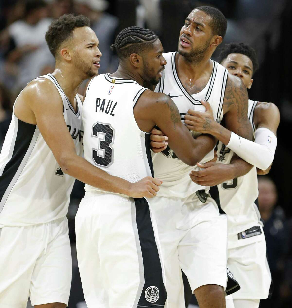 San Antonio Spurs?• LaMarcus Aldridge (center) is separated from Toronto Raptors?• Serge Ibaka (not pictured) by teammates San Antonio Spurs?• Kyle Anderson (from left), Brandon Paul, and Dejounte Murray during second half action Monday Oct. 23, 2017 at the AT&T Center. Aldridge and Ibaka received technicals on the play. The Spurs won 101-97.